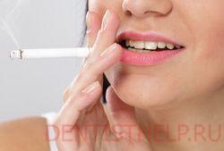 курение - одна из основных причин возникновения желтых зубов